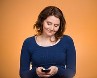 Woman sending text message from her phone Stock Photo
