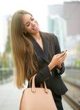 Woman sending text message on phone Stock Photos