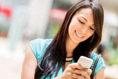 Woman sending a text message Royalty Free Stock Photos