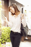 Woman sending text message Royalty Free Stock Images