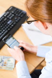 Woman Sending Texts at Work Stock Images