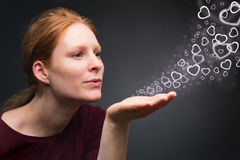 Woman Sends Air Kiss with Hearts Stock Photography