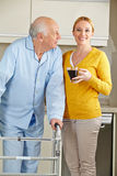 Woman with senior man in kitchen Royalty Free Stock Images