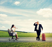 Woman and senior man with suitcase Stock Photography