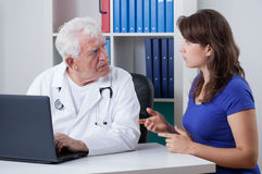 Woman and senior physician Stock Photography