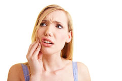 Woman with sensitive teeth Stock Images