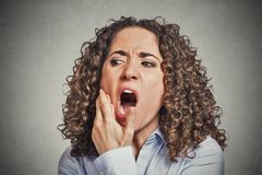 Woman with sensitive tooth ache crown problem royalty free stock image