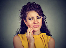 Woman with sensitive tooth ache crown problem about to cry from pain Stock Image
