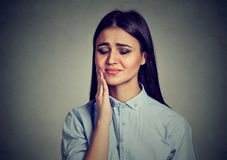 Woman with sensitive toothache crown problem suffering from pain royalty free stock photo