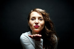 Woman with sensual kiss smile Royalty Free Stock Photography