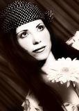Woman in sepia. Woman holding a flower, in sepia Royalty Free Stock Photos