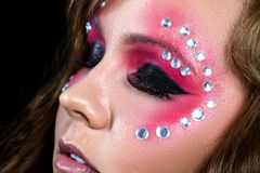 Woman with sequins around eyes Royalty Free Stock Photo