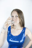 Woman in sequins drinking wine Stock Photo