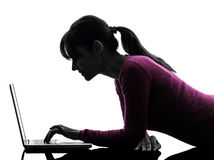 Woman serious computing laptop computer silhouette Royalty Free Stock Images