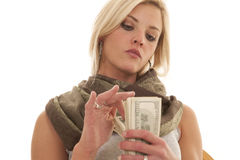 Woman serious counting money Royalty Free Stock Images