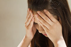 Woman with serious headache Stock Photo