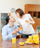 Woman serves breakfast her beloved man Royalty Free Stock Image