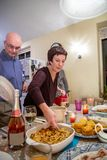 Serving Dinner at Thanksgiving Stock Photo