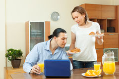 Woman serves morning breakfast her beloved man Royalty Free Stock Photography