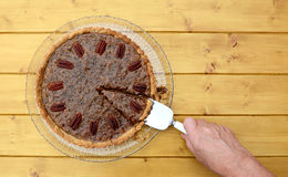 Woman serves a slice of pecan pie Royalty Free Stock Images
