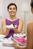 Woman serving birthday cake at party Royalty Free Stock Image