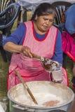 Woman serving chicha Yucay Cuzco Peru Royalty Free Stock Photos