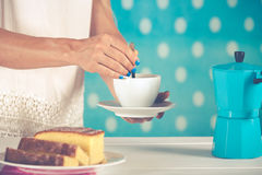 Woman serving coffee Royalty Free Stock Images