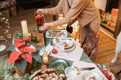 Woman serving christmas dinner table