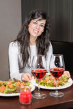 Woman serving dinner Stock Photo