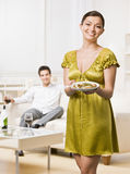 Woman serving elegant dinner to husband Royalty Free Stock Photography