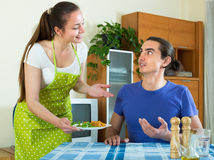 Woman serving food her husband Stock Images