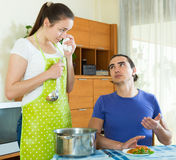 Woman serving food her man at table Stock Photo