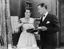 Woman serving food to man Royalty Free Stock Photography