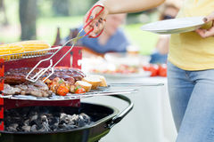 Woman serving grilled steak Royalty Free Stock Images