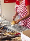 Woman serving hotdog from burger van Stock Photos