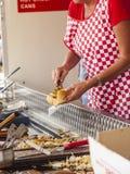 Woman serving hotdog from burger van Stock Photos