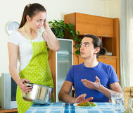 Woman serving lunch her man Stock Photos