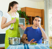 Woman serving lunch her man Stock Images