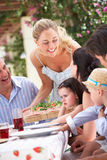 Woman Serving At Multi Generation Family Meal Stock Photos