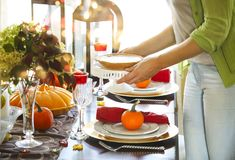 Woman serving pumpkin pie at the Thanksgiving party Stock Images