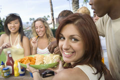 Woman Serving Snacks To Friends Stock Photos