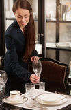 Woman serving table. Stock Photo