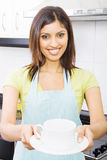 Woman serving tea Stock Image