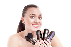 Woman with set of brushes and palette Royalty Free Stock Photo