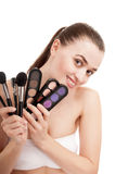 Woman with set of brushes and palette Royalty Free Stock Photos