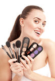 Woman with set of brushes and palette Stock Photo
