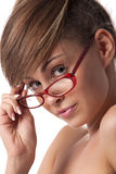 Woman set her glasses straight Royalty Free Stock Image