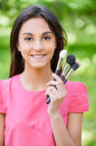 Woman with set make-up of brushes Royalty Free Stock Image