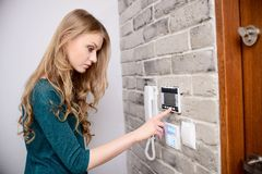 The woman set's the desired temperature. In home heating system Royalty Free Stock Images