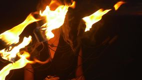 Woman sets fire to the torch and begins to dance stock video